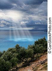Divine light sky above sea - Divine light beams through...