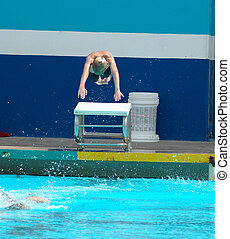 Diving - A teen practices his diving at a local pool.