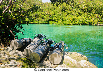 Diving air tanks close to the water