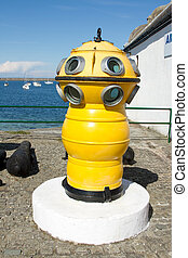 Diving apparatus. - An antique diving bell painted yellow ...