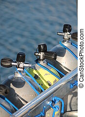 diving cylinder in row on boat water behind