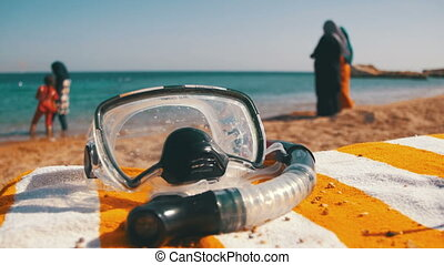 Diving Mask with a Tube for Snorkeling Lying on a Lounger on the Background of the Red Sea Beach in Egypt