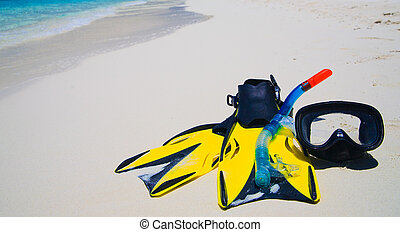 Diving Mask with fins on beach