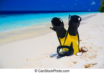 Diving Mask with fins on beach - snorekl equipment on white...