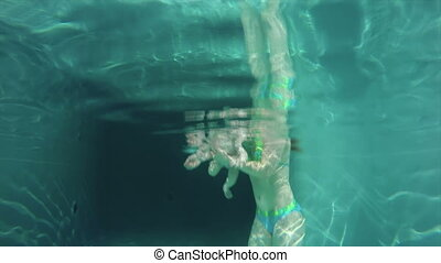 Diving Reflex - Close up of infant submerged under water...
