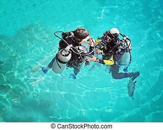Diving - Two divers underwater on top in Red Sea
