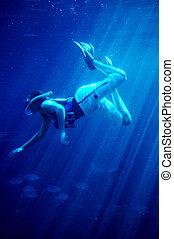 diver in shark tank. Ushaka. Durban, South Africa