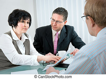 divorce - woman and her lawyer in conversation with husband...
