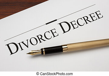 Divorce decree and gold fountain pen shot on warm wood...