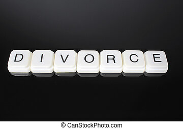 Divorce text word title caption label cover backdrop background. Alphabet letter toy blocks on black reflective background. White alphabetical letters. White educational toy block with words on mirror board table. Black.
