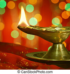 Diwali indian oil lamp with traditional background stock photos a metallic traditional indian lamp illuminated in dark diwali greetings m4hsunfo