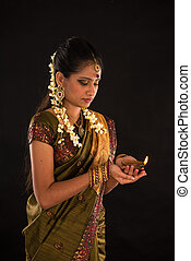 diwali or deepavali photo with female holding oil lamp ...