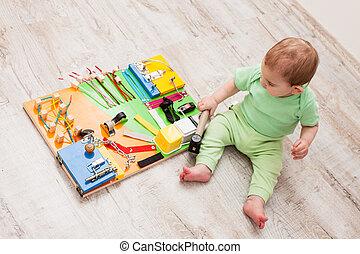 DIY busy board - Handmade DIY sensory children's toy, one...