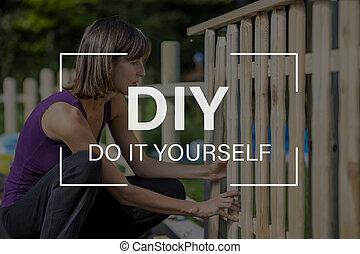 DIY concept with a woman building a garden fence
