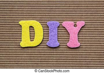 DIY (Do It Yourself) acronym on cardboard background