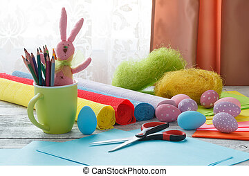 easter, holiday and child concept - close up of coloring easter eggs