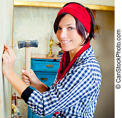Diy fashion woman with nail and hammer on grunge house