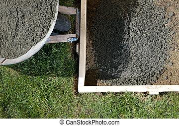 DIY home concrete project closeup with wet cement