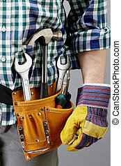 Image of different tools in pocket of repairman