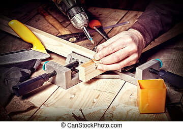 diy work - closeup of carpenter work with  tools