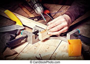 diy work - closeup of carpenter work with  tools