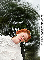 Dizzy woman - Woman feeling dizzy, the world spinning around...