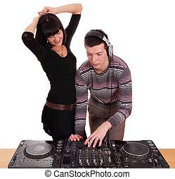 dj and beautiful girl play music and dance