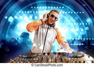 dj and mixer - DJ with a mixer equipment to control sound ...