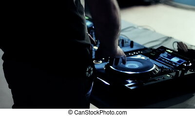 Dj at work in nightclub
