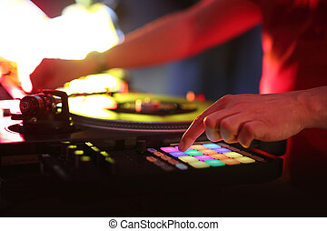 DJ beats with black plate - Hands DJ mixing music at the ...