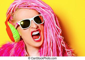 dj bright - Glamorous modern DJ girl wearing bright clothes,...