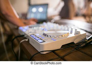 DJ CD player and mixer at wedding