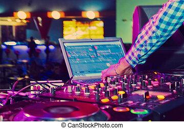 DJ console - DJ mixer at a nightclub. close-up
