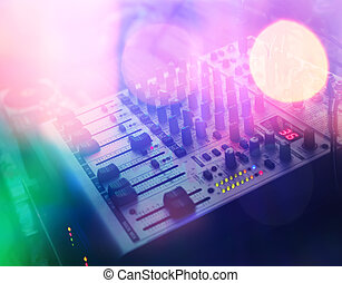 dj console - close-up mixing dj console in colorful disko...