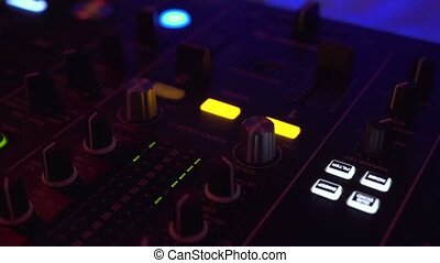 DJ controller for mixing house music and colorful light in...