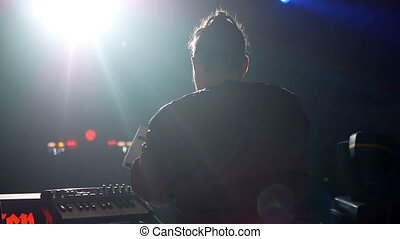 DJ dance party concert - Stage, mixing tracks in atmospheric...