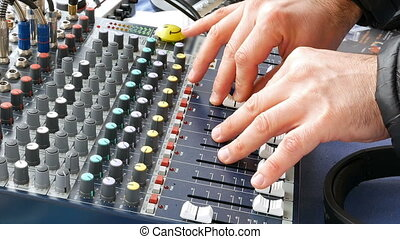 DJ deck mixing console sound board with hands