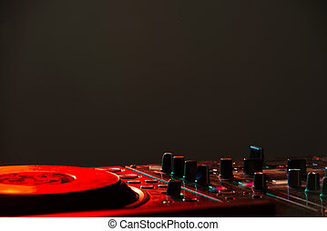 DJ - Dj mixer equipment to control sound and play music.