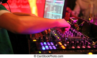 dj - DJ plays music in a nightclub