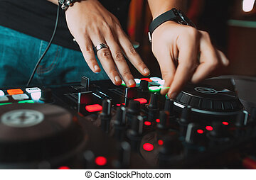 Dj driving the tracks of the console