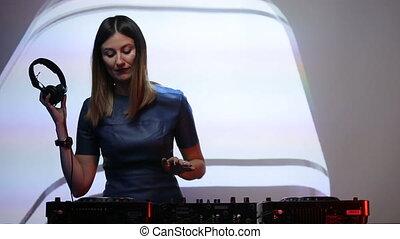 DJ girl on decks at the club