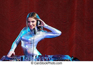 DJ girl on decks at the party