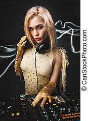 DJ girl on decks on the party