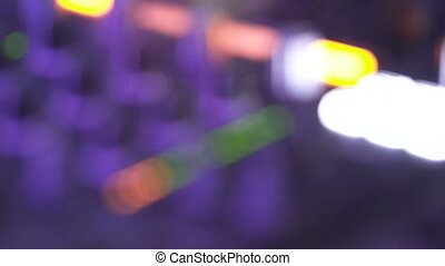 DJ hand behind the decks - Macro closeup hand of DJ on...