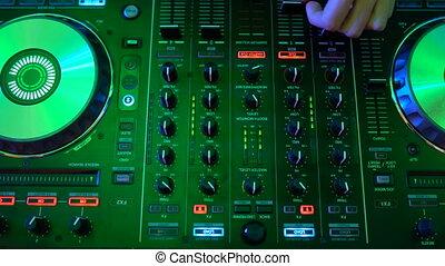 Dj hands on equipment deck
