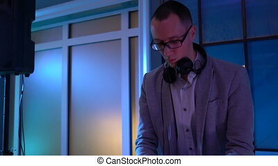 Dj hands on equipment deck and mixer at party