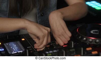 Dj hands on equipment deck and mixer