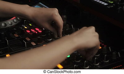 Dj hands on equipment deck at party