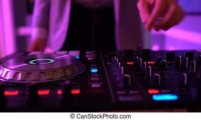 Dj hands on equipment deck