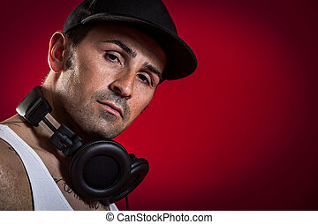 DJ in front of a red Background